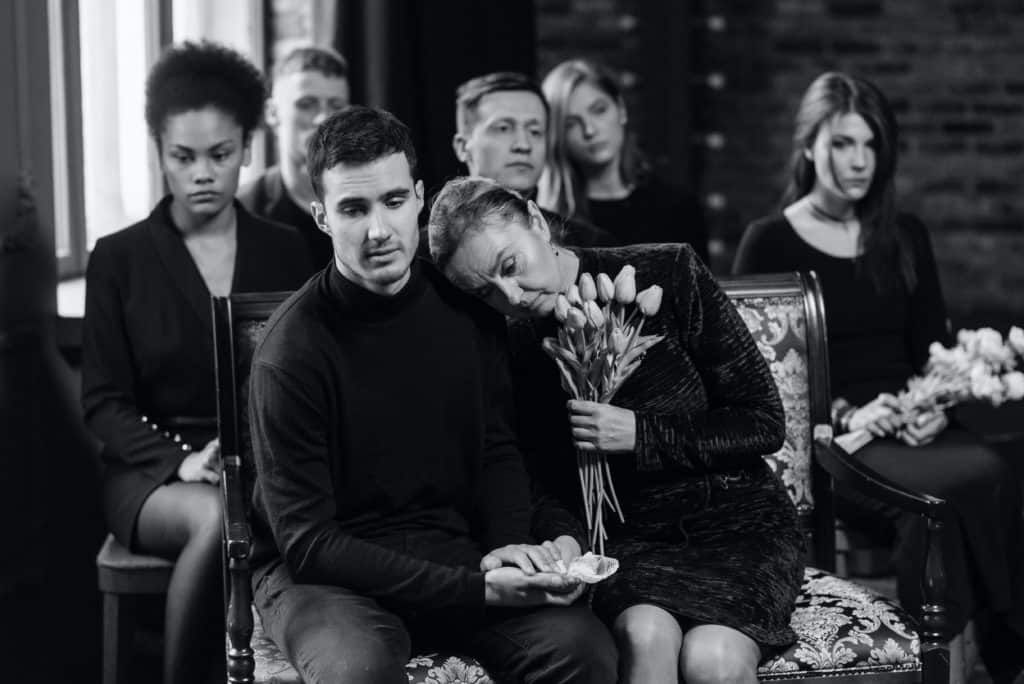 Peopla Wearing Black at a Funeral